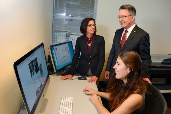 Picture of Ashley Stant showing Tim and Laura Sands the website